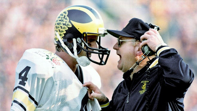In this Jan. 2, 1987, file photo, Michigan head coach Bo Schembechler yells at quarterback Jim Harbaugh as the Wolverines fell victim to Arizona State 22-15 in the Rose Bowl NCAA college football game in Pasadena, Calif.