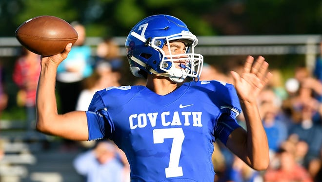 CovCath's AJ Mayer throws a pass down field Friday night.