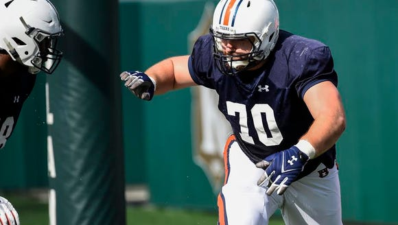 Auburn offensive tackle Robert Leff practices before