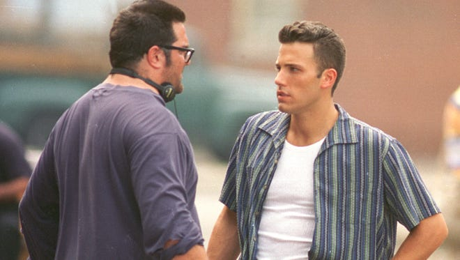 """Director Mark Pellington (left) talks with actor Ben Affleck, during a break in the filming of the movie """"Going All the Way"""" on location in the Fountain Square neighborhood of Indianapolis. It was the movie adaptation of writer Dan Wakefield's coming-of-age story about growing up in Indianapolis in the 1950s."""