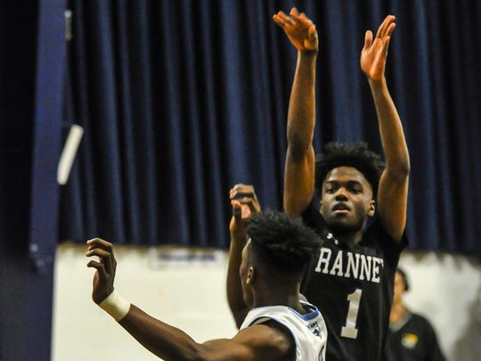Bryan Antoine of Ranney shoots over Jamir Watkins of