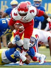 Delaware defensive back Nasir Adderley tackles Stony Brook's Sherman Alston Jr. in 2016 at Delaware Stadium.