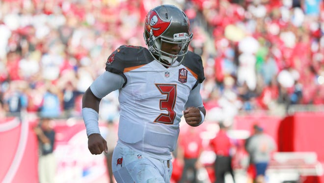 Tampa Bay Buccaneers quarterback Jameis Winston (3) runs off the field at the end of the first half against the Tennessee Titans at Raymond James Stadium.