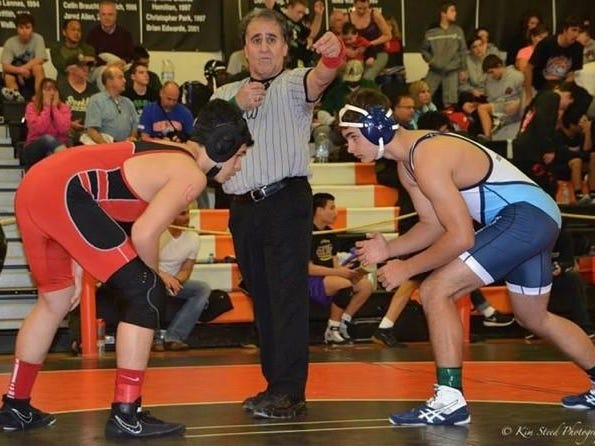 Even after retiring from coaching wrestling, Guevara couldn't stay away from helping the sport he loves.