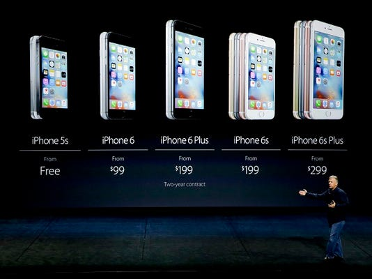 Phil Schiller, Apple's senior vice president of worldwide marketing, talks about the pricing of the new iPhone 6s and iPhone 6s Plus during the Apple event at the Bill Graham Civic Auditorium in San Francisco, Wednesday, Sept. 9, 2015. (AP Photo/Eric Risberg)