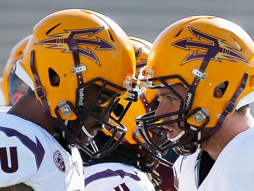 Arizona State's Taylor Kelly, right, bangs helmets with Jaelen Strong prior to an NCAA college football game against New Mexico, Saturday, Sept. 6, 2014, in Albuquerque, N.M.
