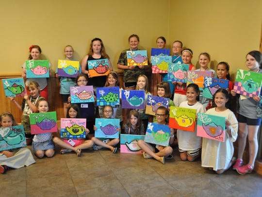 """Jane in June"" campers pose with their paintings on Tuesday, the second day of the Kent Plantation House's annual summer camp."