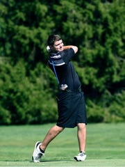 Josh Noe, of River View, watches his tee shot on the 17th hole on Wednesday during the second round of the East Central Ohio League Tournament at River Greens. Noe shot 83.