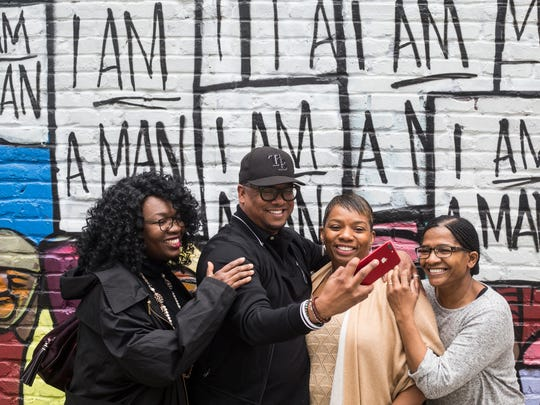 "March 29, 2018 - From left, Dr. Tiffany Tyler, Dr. Malcolm Gillard, Angella Chalk, and Charlotte Morgan, take a selfie together in front of the ""I am a Man"" mural along South Main Street. The group was visiting Memphis from Las Vegas. Tens of thousands of visitors are expected in Memphis starting this weekend to see the events marking the 50th anniversary of the late civil rights leaderÕs assassination at the Lorraine Motel on April 4, 1968."