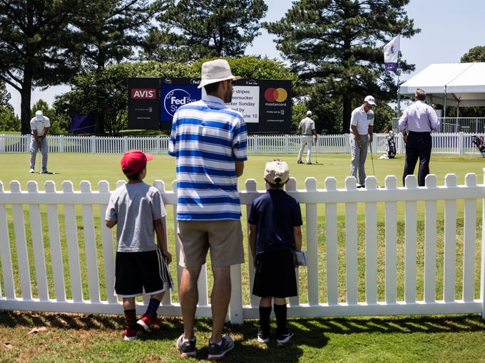 June 04, 2018 - People watch as golfers use the practice