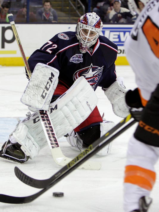 Columbus Blue Jackets' Sergei Bobrovsky, of Russia, makes a save against the Philadelphia Flyers during the third period of an NHL hockey game Tuesday, Dec. 9, 2014, in Columbus, Ohio. The Blue Jackets beat the Flyers 3-2. (AP Photo/Jay LaPrete)