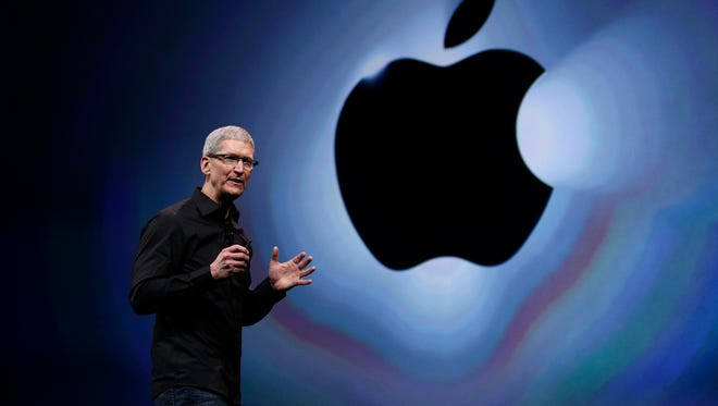 Up and at 'em: Apple CEO, who typically gets out of bed at 3:45 a.m. presents a new iPhone.
