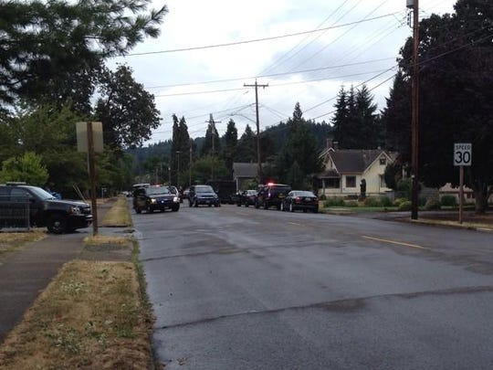 Officers from several law enforcement agencies respond to shooting on Olson Street in Silverton, Ore.