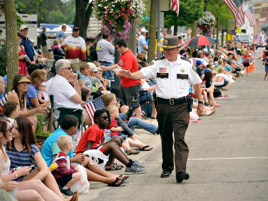 Stearns County Sheriff John Sanner walks the parade route talking to people during the St. Joseph Parade Friday, July 4. Sanner is running for re-election as Stearns County Sheriff.