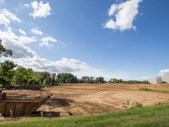 Construction crews work at the future site of a Wegmans grocery store at U.S. 1 and U.S. 202, in the Painters Crossing area of Pennsylvania about 3 miles north of the Delaware line.