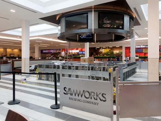 Sawworks Brewing is the centerpiece of West Town Mall's new dining area.