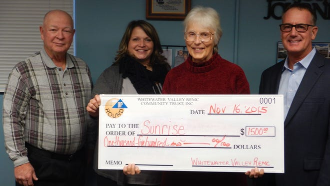 Whitewater Valley Community Trust board members Bruce Cowen, Carol McQueen and Michael Allen present a check to Sunrise's treasurer Janice Edelman, third from left.