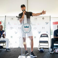 Golden State Warriors guard Stephen Curry attends a news conference at Langston Golf Course in Washington, Monday, Aug. 19, 2019, where Curry announced that he would be sponsoring men's and women's golf teams at Howard University. (AP Photo/Andrew Harnik)