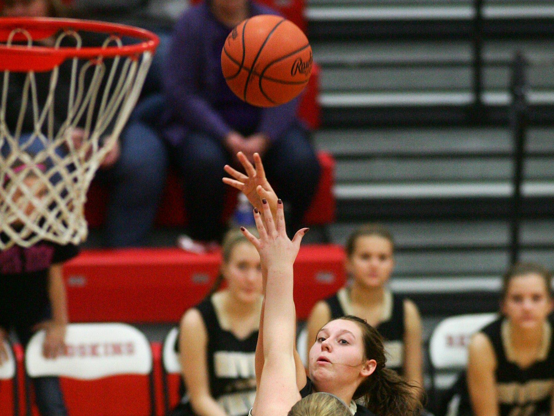 Coshocton sophomore Abby Zimomra puts pressure on River View freshman Cydne Whiteus as she takes a shot Wednesday during the Black Bears' 41-28 victory in Coshocton.
