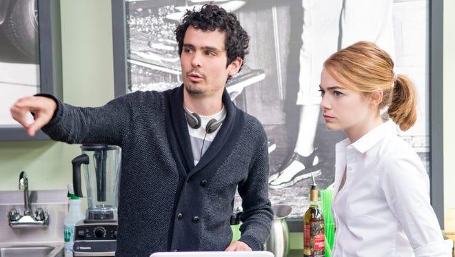 "Director Damien Chazelle and Emma Stone on the set of ""La La Land."""