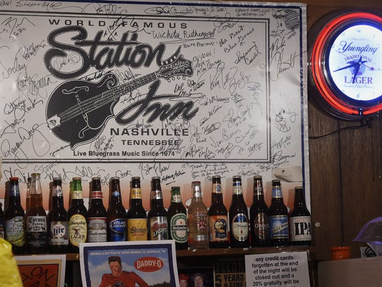 Old posters decorate the walls inside The Station Inn