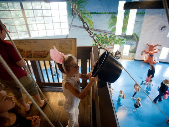 Aurora Phillips, of Palm City, plays with other children while on the galleon during 2015's Halloween Trick or Treat event at The Children's Museum of the Treasure Coast in Jensen Beach.