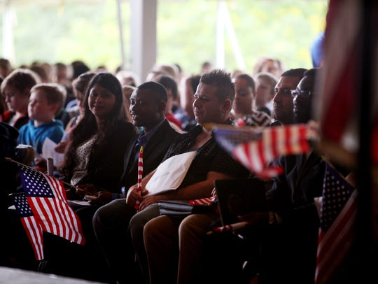 New American citizens attend a naturalization ceremony
