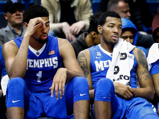 University of Memphis teammates, from left, Dedric Lawson, K.J. Lawson, Jeremiah Martin and Kaleb Castro watch from the bench during an 84-54 loss to Central Florida University during first-half action of their second-round American Athletic Conference tournament game in Hartford, Conn.