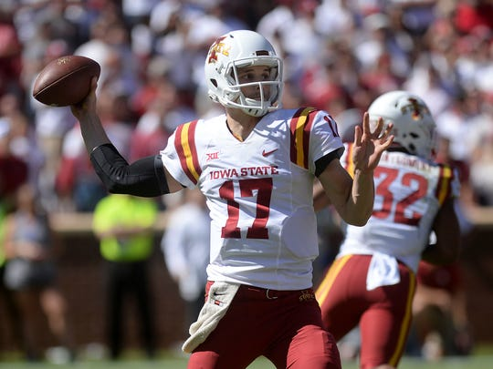Oct 7, 2017; Norman, OK, USA; Iowa State Cyclones quarterback Kyle Kempt (17) passes the ball against the Oklahoma Sooners during the third quarter at Gaylord Family - Oklahoma Memorial Stadium. Mandatory Credit: Mark D. Smith-USA TODAY Sports