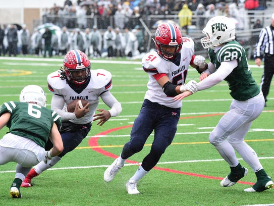 Franklin's Isaac Moore (7) goes for the 1-yard TD run