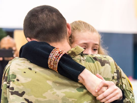 Megan Mathis gets a hug from her brother Nick Tumelty-Mathis