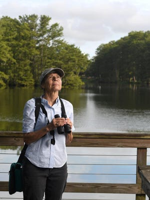 Nancy Buckingham, program chair with Cape Fear Audubon, stands at Greenfield Lake in Wilmington, N.C., Friday, July 10, 2020.