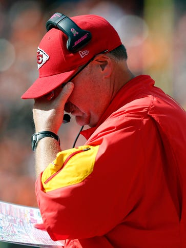 Kansas City Chiefs head coach Andy Reid reacts from