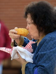 "Rosalie Estep, from Pleasantville, takes a bite from a onion ring Thursday at the Fairfield County Fair in Lancaster. Estep was at the fair is Della Bradford, from Lancaster, not pictured. The two were enjoying a basket of deep fried vegetables. ""We're getting our veggies today,"" Estep said as she laughed."