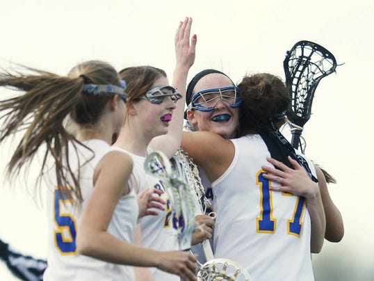 Hugs all around for Kennard-Dale's Morgan Day, as she broke what was reported to be the PIAA career goals record.