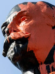 The controversial Castleman statue took a direct hit from orange paint back in April 2018.
