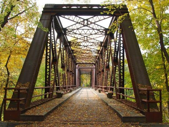 A railroad bridge carries the Wallkill Valley Rail