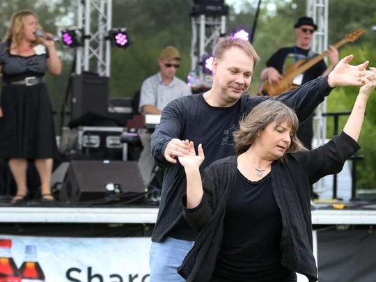 Deena Stevens dances with her husband, Michael, as the Ray Gordon Band plays Saturday at The Bite & Brew of Salem.