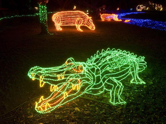 Animals are lit up for Christmas season at the Oregon Zoo.