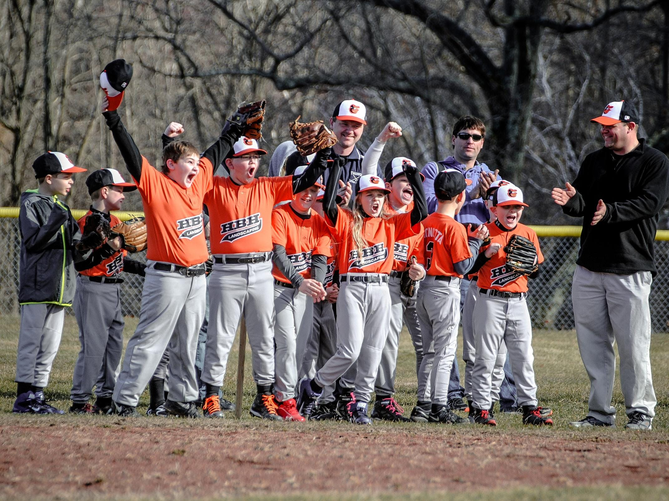 The HBH Landscaping Orioles cheer during the Taconic Little League's 2015 Opening Day in Stanfordville.