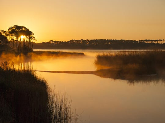 "Phoographer Nic Stoltzfus shot this sunset photo of Western Lake in Grayton Beach State Park while filming the nature documentary ""Coastal Dune Lakes: Jewels of Florida's Emerald Coast."""