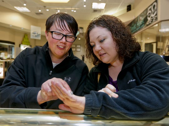 Angie Rolando, left, and her same-sex partner, Tonya, shop for wedding rings after a federal judge overturned Montana's gay marriage ban.