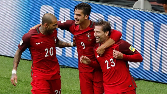 Portugal's Adrien Silva, right, celebrates with teammates Ricardo Quaresma, left, and Andre Silva after scoring his side's second goal during the Confederations Cup's third-place soccer match against Mexico.