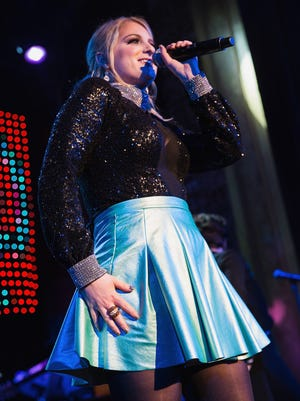 Meghan Trainor performs on stage during 'That Bass Tour' at the Neptune Theatre on February 14, 2015 in Seattle, Washington.