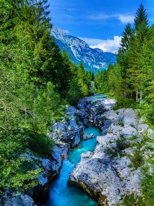 The milky green Soca River flows beneath the Julian Alps in Slovenia.