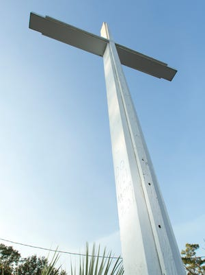 """The phrase """"Do Not Move God"""" is seen etched into the Bayview Park cross on Nov. 17, 2017."""