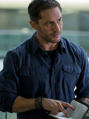 "Eddie Brock (Tom Hardy) is a journalist whose life gets very complicated when he becomes the host for an alien life form in ""Venom."""
