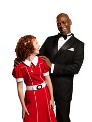 """Vivian Poe as Annie and Charles E. Wallace as Oliver """"Daddy"""" Warbucks in Alabama Shakespeare Festival's production of """"Annie."""""""