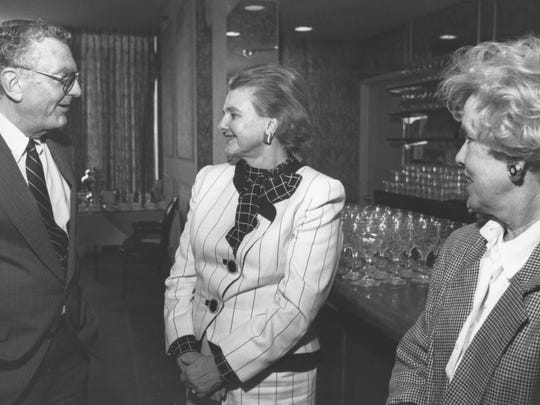 J. Willis Johnson III speaks with Dallas civic leader Caroline Hunt and Ta Cargile at an event in 1991.