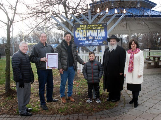 Union County Freeholder Chairman Bruce H. Bergen and Union County Manager Alfred Faella joined Rabbi Mordechai Kanelsky and representatives from Bris Avrohom of Hillside to light the menorah for Chanukah in Phil Rizzuto Park in Elizabeth.